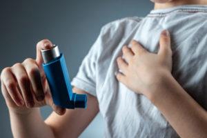 boy with asthma using inhaler