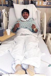 Osvaldo Ramirez recovering in hospital bed