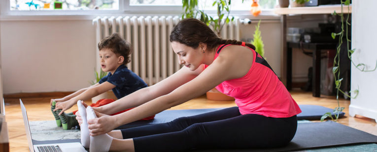 Woman and Child Exercise at Home