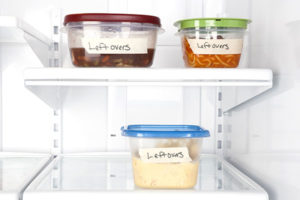 Leftover food containers in refrigerator