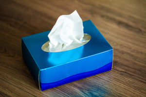 Box of facial tissues on office desk.