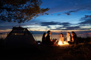 People gathering around a campfire.