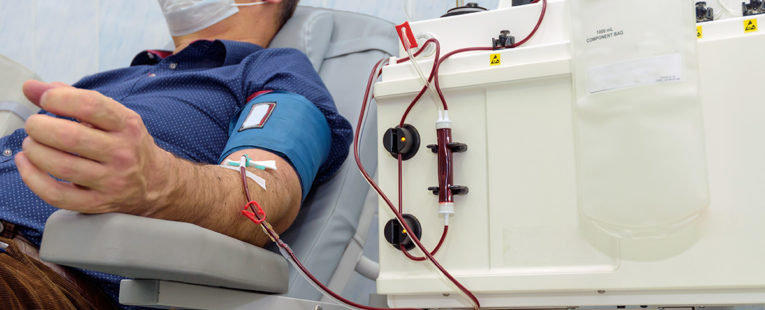 Man donating blood to help COVID-19 patients