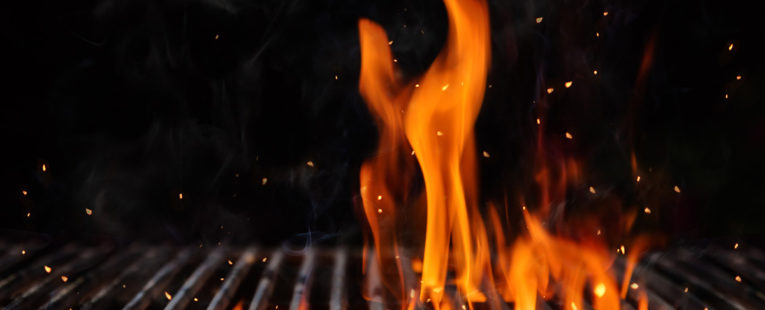 Flames on a bbq grill.