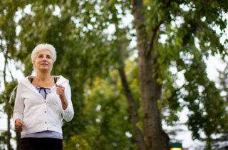 Senior woman jogging outdoors.