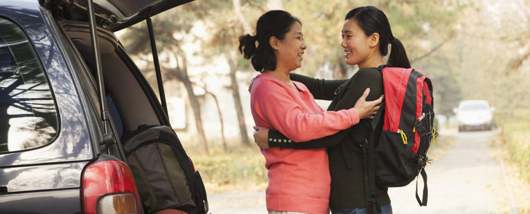 Asian-American mother dropping off daughter at college.