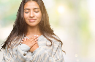 woman taking a self-compassion break