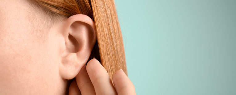 Young woman with ear infection.
