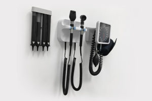 Otoscope hanging on wall in health care provider's office