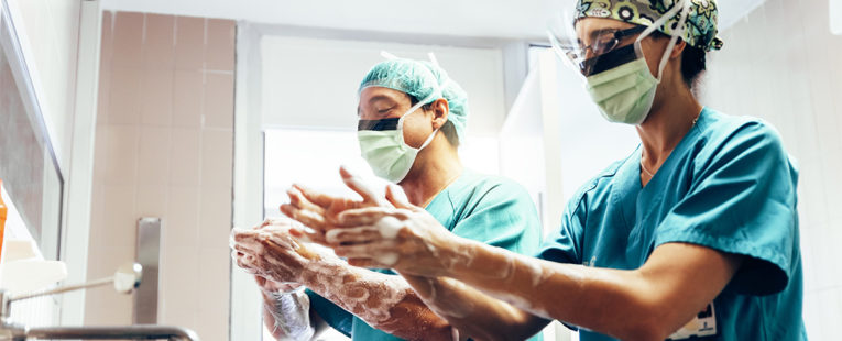 Two surgeons washing hands prior to elective surgery
