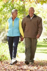 Active African-American senior couple on an autumn walk