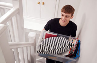 College-aged male bringing school supplies home.