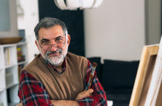 Middle-aged man in artist studio considering lung cancer screening.