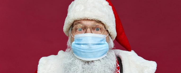 Surprised Santa wearing a mask
