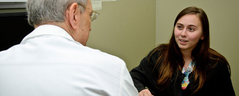 patient talking with a doctor withn an exam room
