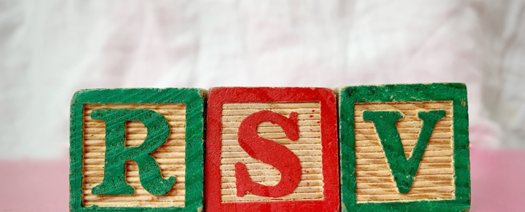 "three childrens blocks spell out ""RSV"""