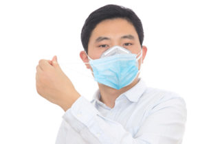 Asian-American man wearing two face masks