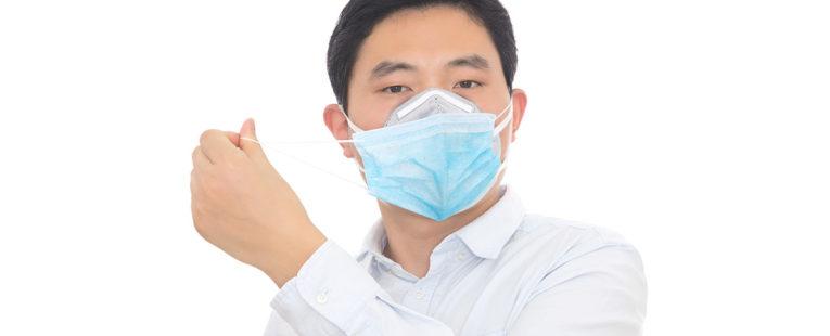 Asian-American man wearing two face masks