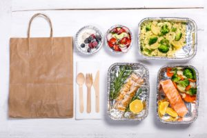 healthy food prepared in carry out boxes ready for a brown bag delivery