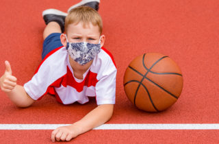 young basketball player returning to sports after COVID-19