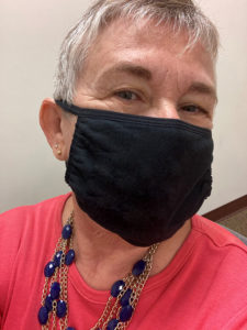 Joni Vujovich wears face mask in office during COVID-19 vaccine clinical trial