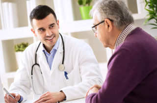 Man talking to doctor about care plan