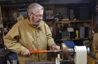 David Alfredson turning a wooden bowl on a lathe