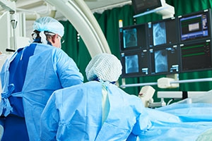 Cardiologists performing angioplasty