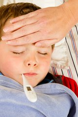 Boy with fever and thermometer