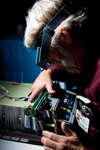 Equipment Technician Repairing Medical Equipment