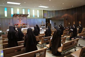 Sisters Praying During Mass