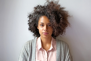 Young African-American woman in a grey sweater