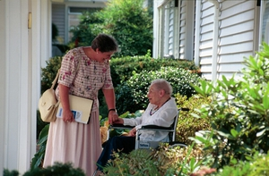 OSF Hospice volunteer with patient