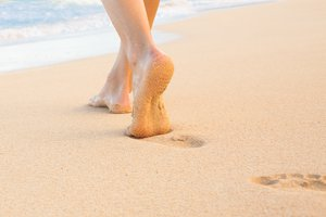 Bare Feet Walking On Beach