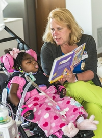 Almost Home Kids Nurse Reading to Patient