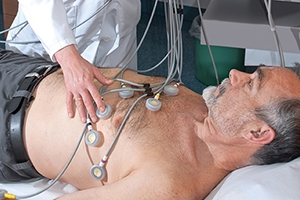 Male patient receiving an EKG test.