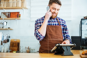 Smiling Barista Taking Order by Phone