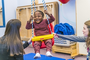 OSF HealthCare pediatric rehabilitation specialist working with child