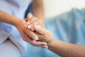 hospitalist holding patient's hands