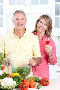 Couple in Kitchen with Healthy fruit salad