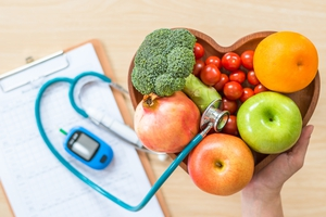 Basket of vegetables and fruit next to a stethoscope