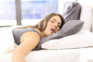 Snoring Woman in Bed