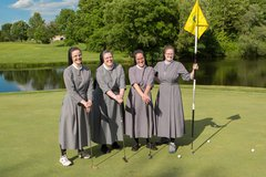 Sisters enjoy a day on the links in support of cancer program.