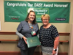 Photo of Amanda Davis, RN, accepting her DAISY Award from Mary Beutke, the patient who nominated her.