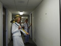 Roxanna Crosser, President of OSF St. Mary Medical Center,  takes a swing at the wall