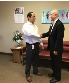 Dr. Abraham Cambepll and Matt Krause, Director of Physician Offices