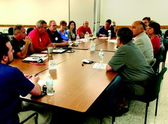 Photo of Live Well Streator steering committee and community members tackling healthy weight and substance abuse issues.