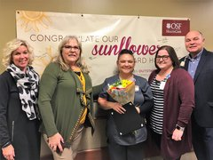 Josie Rodriguez, February Sunflower Award Winner, with OSF Saint Elizabeth Leadership.