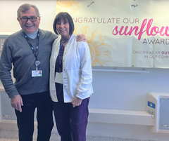A photo of Dr. Celeboglu, General Surgeon, with LouAnn Chalkey, Sunflower Award Recipient.
