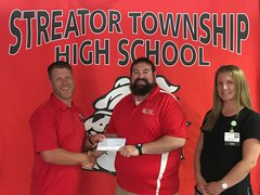 Rory Bedeker, Streator Township High School Athletic Director, accepts a $1,225 donation from OSF HealthCare represented by Brad Yates, Supervisor of Athletic Training, and Megan Brandt, APRN, in Orthopedics.